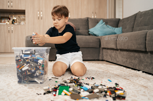 School boy playing lego at home - Stock Photo - Images