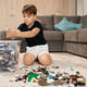 School boy playing lego at home - PhotoDune Item for Sale