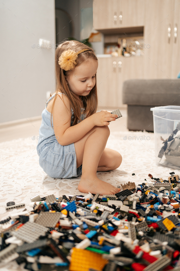 Cute girl playing lego at home - Stock Photo - Images