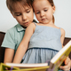 Brother teaches his little sister to read - PhotoDune Item for Sale