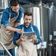 Men inspectors with digital tablet technician inspecting modern beer factory plant - PhotoDune Item for Sale