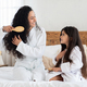 Fair-haired brunette mother and little daughter brushing hair - PhotoDune Item for Sale