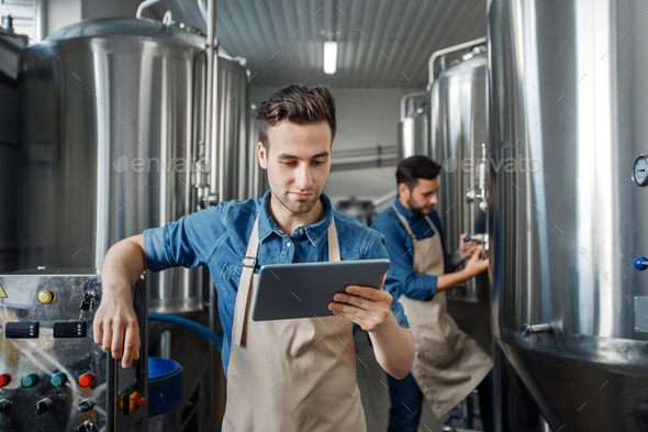 Smart factory, modern brewery management and craft beverage production - Stock Photo - Images