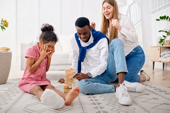 Happy family play game in living room - Stock Photo - Images