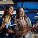Cheerful women talks in night office - PhotoDune Item for Sale