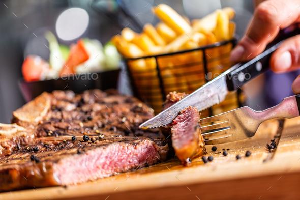 Beef steak in american restaurant - Stock Photo - Images