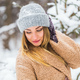 Attractive young woman in winter time outdoor. Snow, holidays and season concept. - PhotoDune Item for Sale