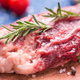 Fresh raw meat for steak on wooden cutting board, close-up. - PhotoDune Item for Sale