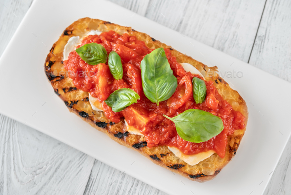 Grilled bread with mozzarella and tomatoes - Stock Photo - Images