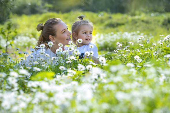 Having Fun in Daisies Field - Stock Photo - Images