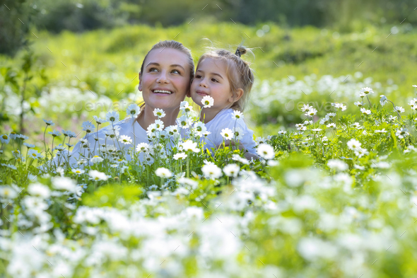 Mother and Son on Flowers Field - Stock Photo - Images