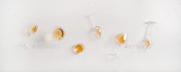 Flat-lay of trendy Orange or Amber wine in different glasses - Stock Photo - Images