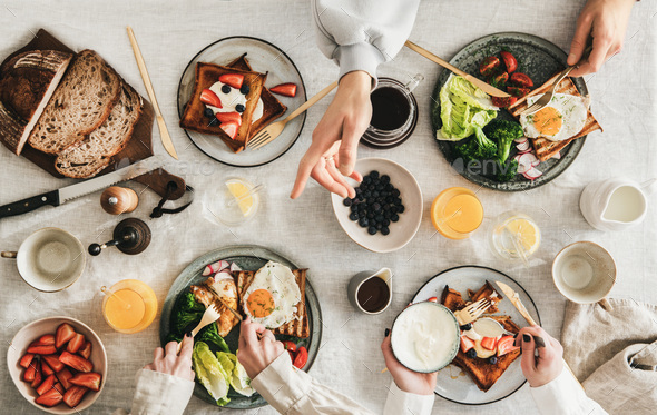 Group of people Friends having breakfast or gathering brunch - Stock Photo - Images