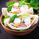 Pita stuffed with chicken, tomato, cucumber and spinach on wooden background. - PhotoDune Item for Sale