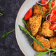 Boiled bulgur, roasted chicken nuggets and fresh tomatoes salad. - PhotoDune Item for Sale