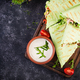 Fresh tortilla wraps with chicken and fresh vegetables on wooden board. - PhotoDune Item for Sale