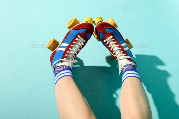First person POV of the legs of a woman wearing roller skates - Stock Photo - Images