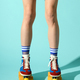 Legs of a slender sporty woman wearing multicolored roller skates - PhotoDune Item for Sale