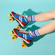 Young woman with thin skinny legs wearing colorful roller skates - PhotoDune Item for Sale