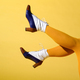 Sexy legs of a woman wearing mustard colored stockings - PhotoDune Item for Sale