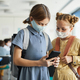 Young Girls using Smartphone in School - PhotoDune Item for Sale