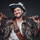 Smiling buccaneer with handguns against dark background - PhotoDune Item for Sale