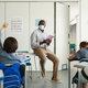 African American Teacher Wearing Mask in Class - PhotoDune Item for Sale