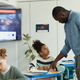 Teacher Helping Children in Class - PhotoDune Item for Sale