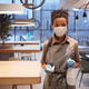 Young Woman Sanitizing Table in Food Court - PhotoDune Item for Sale