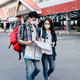 Young backpacker couple in mask checking location on paper map - PhotoDune Item for Sale