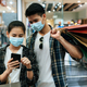 Young couple in mask holding multiple shopping paper bag - PhotoDune Item for Sale