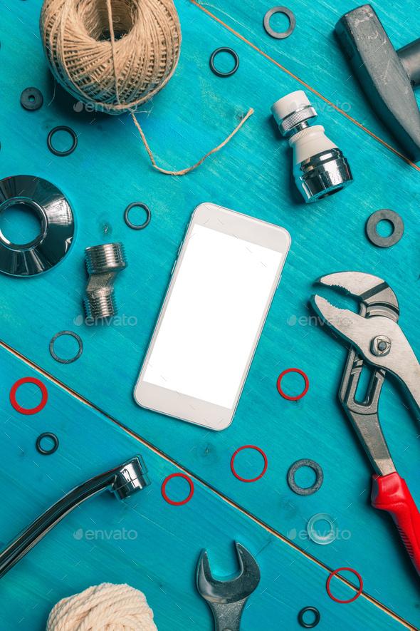 Plumbing DIY tutorial app smartphone mock up - Stock Photo - Images