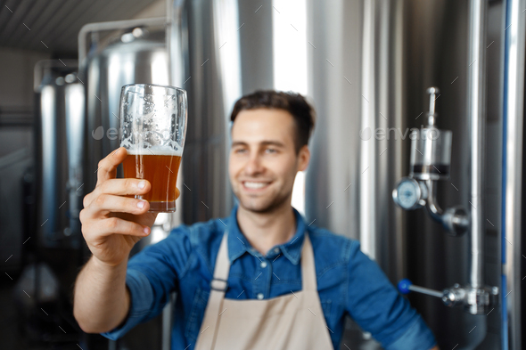 Quality control, tasting and enjoying fresh craft beer - Stock Photo - Images