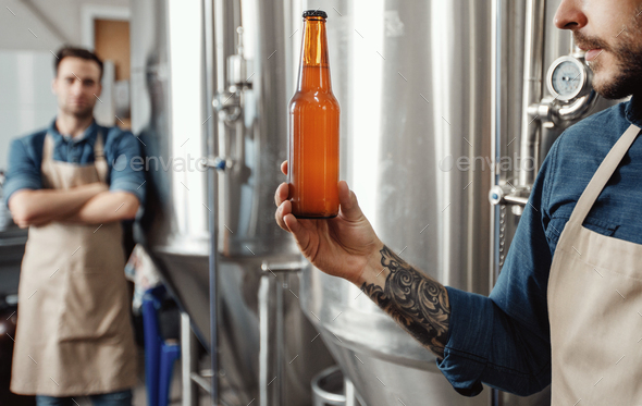 Fresh craft beer, quality control of ready to sell alcoholic beverage - Stock Photo - Images