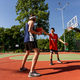 Two millennial sportsmen playing basketball match at outdoor playground, blank space - PhotoDune Item for Sale