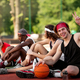 Happy young basketball player and his multinational team having rest at outdoor arena, copy space - PhotoDune Item for Sale