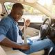 Positive black man fastening car seat belt - PhotoDune Item for Sale