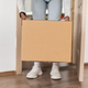 Unrecognizable African American Lady Taking Delivered Box From Floor Indoor - PhotoDune Item for Sale