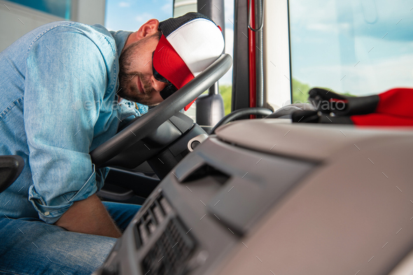 Semi Truck Driver Sleeping on the Steering Wheel - Stock Photo - Images