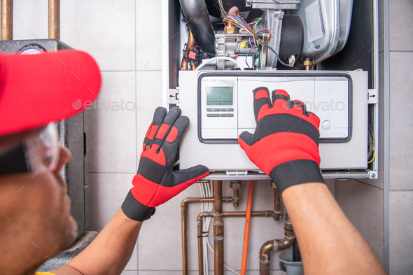 Gas Heater Repairing Performed by Caucasian Technician - Stock Photo - Images