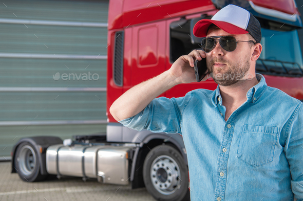Truck Driver Ordering New Tractor Parts by Phone - Stock Photo - Images