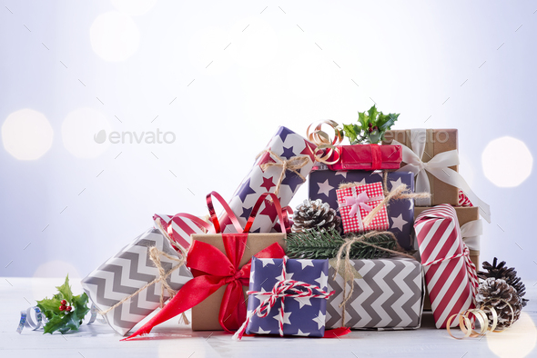 Christmas gift boxes on blue bokeh background - Stock Photo - Images