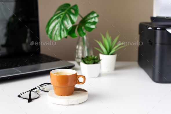 Cup with coffee near laptop on work from home in living room. Break time - Stock Photo - Images
