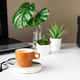 Cup with coffee near laptop on work from home in living room. Break time - PhotoDune Item for Sale