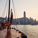 Traditional Junk boat against Hong Kong cityscape - PhotoDune Item for Sale