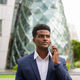 Portrait of African businessman outdoors in city talking on mobile phone - PhotoDune Item for Sale
