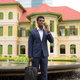 Full length shot of African businessman outdoors talking on mobile phone - PhotoDune Item for Sale