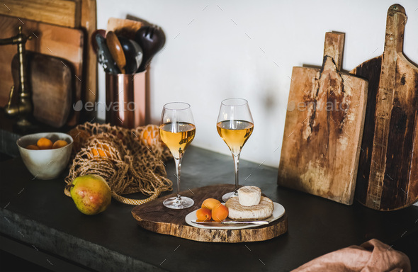 Two glasses of Orange or Amber wine and appetizers - Stock Photo - Images