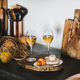 Two glasses of Orange or Amber wine and appetizers - PhotoDune Item for Sale