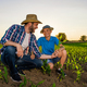 Family cultivating corn - PhotoDune Item for Sale